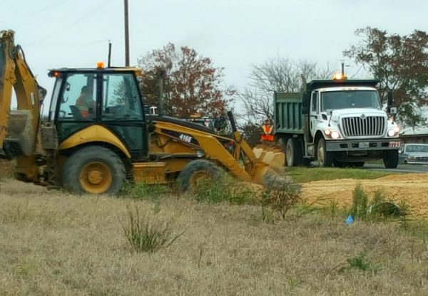 Driveway placement options: by the third dump truck delivery they were able to drive across the drainage ditch | Rockin W Homestead