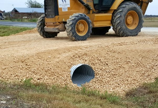 Driveway placement options: each truck load was thoroughly packed down to prevent erosion during runoff and rains | Rockin W Homestead