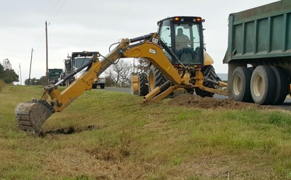 Driveway placement options: digging down at the road and under the pipe | Rockin W Homestead